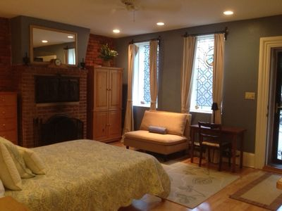 Boston apartment rental - Bed, couch, writing desk, stained glass windows