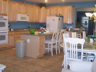 Sunset Island Ocean City townhome photo - Big enough for the entire Clan! Table seats 14-16