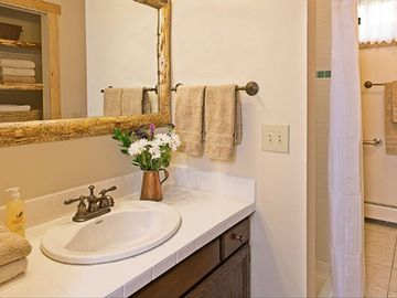 One of two full bathrooms, luxury linens, shampoo, bath soap, tissues