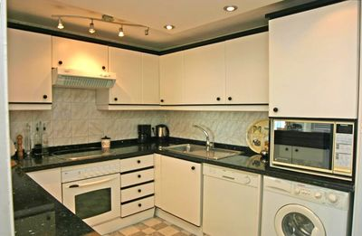 Fully equipped large modern kitchen with granite work top