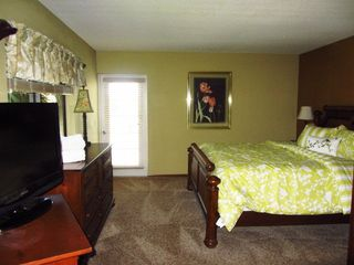 Master Suite with balcony access - Cocoa Beach condo vacation rental photo