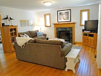 Family room with 42 inch flat screen tv and all new furniture and fireplace