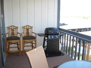 Osage Beach condo photo - New grill and extra chairs.