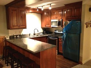 Jay Peak condo photo - Brand new kitchen,in pic, we have not taken the plastic sheets off appliances