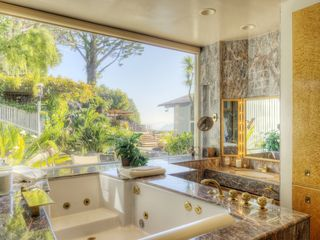 Master bedroom shower, bathtub and vanity area with views of patio and SF Bay. - Tiburon house vacation rental photo