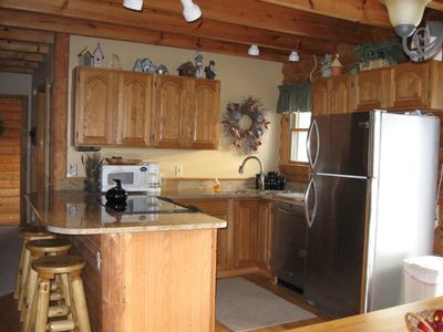 All new kitchen w/granite counterops and snack bar