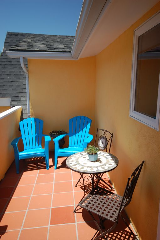 Private terrace with bistro set, beach chairs and gas grill