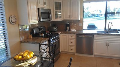 New granite & cabinets with stainless appliances. Everything you need is here.