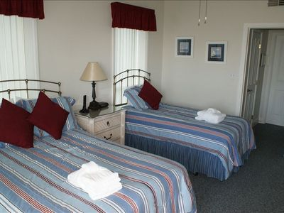 2nd bedroom has a full & twin sized bed.  Direct access to balcony.  Great view.