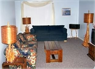 Spacious living room with sleeper sofa, large couch and double recliner.