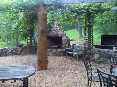 Relax on the Back Patio Area While Enjoying a Bbq Sitting by the Fire