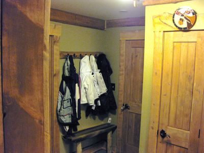 Take the elevator up to the Entrance. Hang up your ski equipment in the mudroom