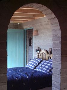 Adobe archway in main bedroom