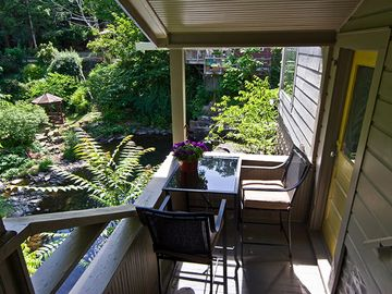 Private covered balcony overlooking Tannery Brook waterfall