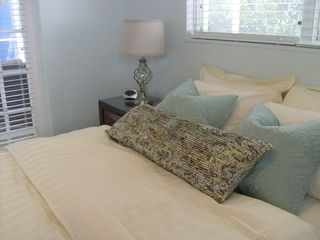 Well appointed master bedroom with french door to lanai - Siesta Key house vacation rental photo