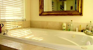 OVERSIZED JAZUZZI FOR TWO IN MASTER BATHROOM.