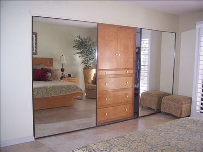 Large Master mirrored closet with TV cabinet and drawers.