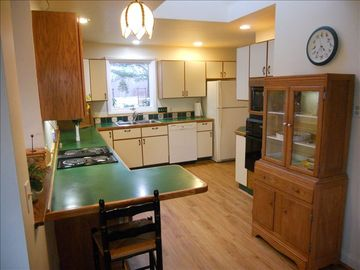 Large kitchen to delight any chef, w/oven, microwave, dishwshr...views of garden