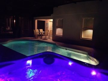 Spa with mood lighting & Pool by night