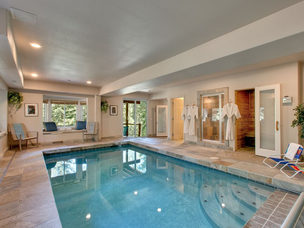 Splendid lodge w indoor heated swimming homeaway for Swimming pool room ideas