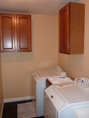 Las Vegas house photo - Washer, dryer and sink in large laundry room with supplies.Leads to garage.