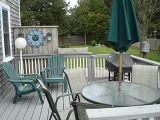 Pocasset house photo - backyard deck off of kitchen - rear of house