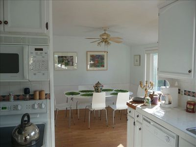 Fully appointed kitchen and dining room.