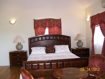 Partial view of master bedroom suite showing king-sized bed