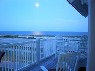 Ocean Isle Beach condo photo - Night time deck view with seating for 6 to dine