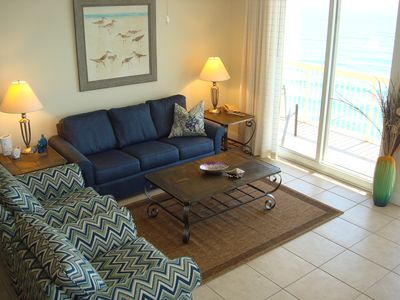 Spacious living area with new furnishings & beach themed decor throughout