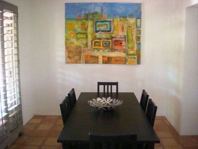 Beautiful Dining area with unique artwork.