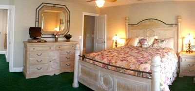 Master has king bed. Master bath has dual vanities, granite  and spa tub
