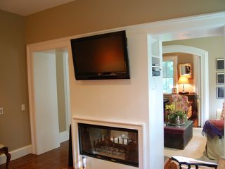 Bridgehampton house photo - den with fireplace and flatscreen television and full hideabed sofa