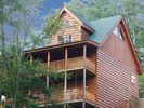 3 LEVELS OF LUXURY w/ 2 DECKS ROCKERS SWING & 2 BBQ GRILLS! - Sevierville cabin vacation rental photo