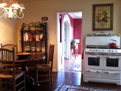 The warm, inviting kitchen is fully stocked and has a Merrit Okeefe gas stove.