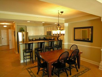 Dining Room w/ Table Seating for 6 and Bar Seating for 4