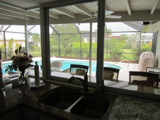 Vacation Homes in Marco Island house photo - Sliding pass-through windows to outside bar