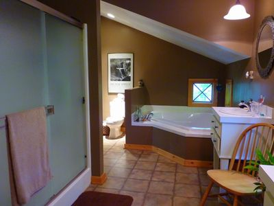 Luxurious bathroom off the master bedroom on the second floor.