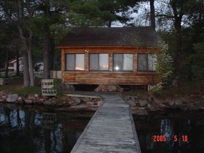 The smaller cottage from it's dock