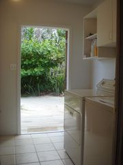 Cayman Brac house photo - large laudry room downstairs with plenty of extra storage space