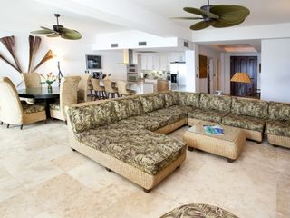 Cupecoy condo photo - Overview of Living area w/ Kitchen and Dining table in the background