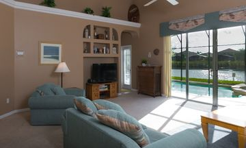 Serenity villa rental - Living room overlooking the pool and lake