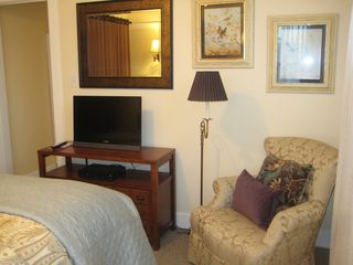 Long Beach apartment photo - A 2nd TV in the bedroom & a boudoir chair for relaxing