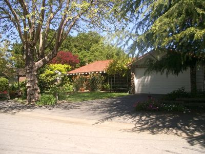 Front view and driveway, entry gate to the right.