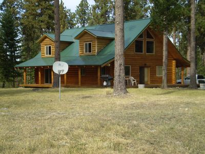 The Real Deal Log Home includes 3 decks, patio furniture and a BBQ grill.