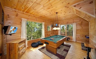 Have fun at the gameroom with dartboard and pool table.