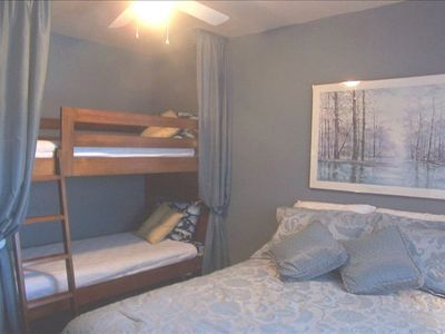 Adult-sized bunk beds in second bedroom