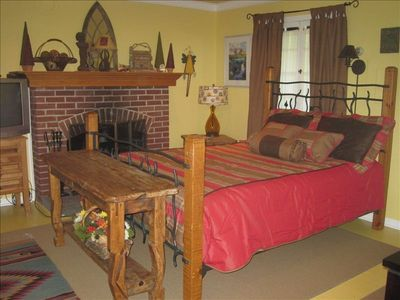 Queen size bed and fireplace