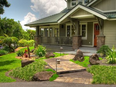 Charming cobblestone path leads to the Craftsman columned entry