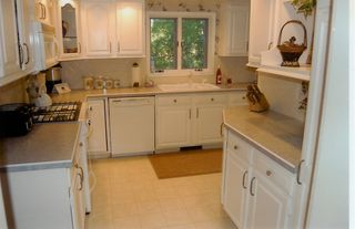 Traverse City house photo - Fully equipped kitchen w/beautiful lake view